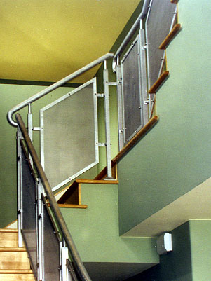 Aluminum Staircase Railing With Sanded Finish And Perforated Screen.